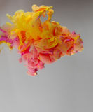 Acrylic colors and ink in water. Stock Photography