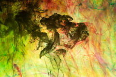 Acrylic colors and ink in water Stock Photography