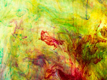 Acrylic colors and ink in water. Royalty Free Stock Photos