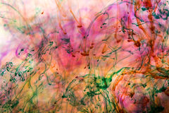 Acrylic colors and ink in water. Stock Photo