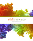 Acrylic colors and ink in water. Abstract frame background. Royalty Free Stock Images