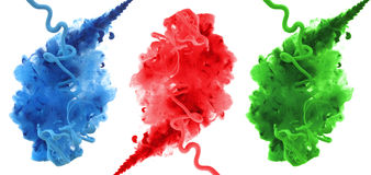 Acrylic colors and ink in water. Royalty Free Stock Photo
