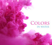 Acrylic colors in water, abstract background. Royalty Free Stock Image