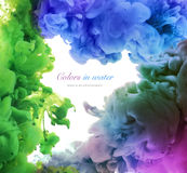 Acrylic colors in water. Abstract background. Stock Images