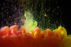 Acrylic colors in water. Abstract background royalty free stock photography