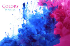 Acrylic colors in water background. Royalty Free Stock Image