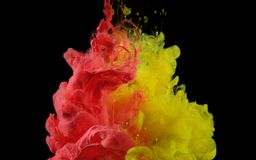 Acrylic colors in water. Ink blot royalty free stock images