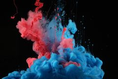 Acrylic colors in water. Ink blot. Abstract background stock image