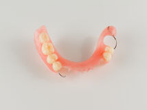 Acrylic denture with metal clasps Stock Image