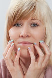 Acrylic fingernails Stock Photo