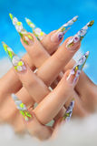 Acrylic flowers on women's nails. Royalty Free Stock Images