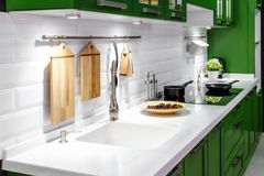 Acrylic kitchen sink built into the countertop stock images