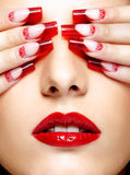 Acrylic nails manicure. Face with eyes closed by fingers with acrylic french nails manicure stock photos