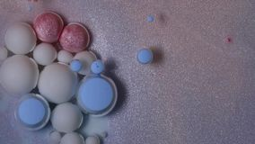 Acrylic paint balls in oil. stock footage