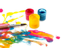 Acrylic paint with brush Stock Images