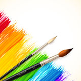 Acrylic painted rainbow background with brushes Stock Photography
