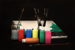 Acrylic. Watercolor paint, brushes and canvas stock illustration