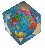Acrylic world globe. Retro world globe in a square acrylic cube, a child's toy from the 1960s royalty free stock image