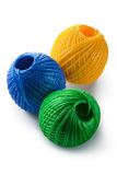 Acrylic yarn clews - green, blue and yellow. Placed on white background Royalty Free Stock Image