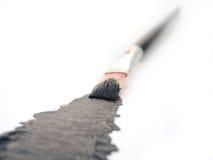 Acryllack mit Pinsel Stockfoto