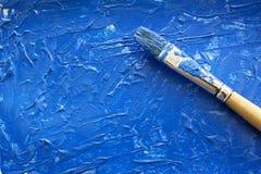 Acrylmalerei des blauen Aquarells mit Bürste an Lizenzfreie Stockbilder