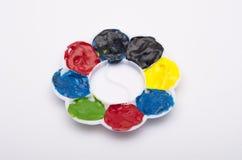 Acrylmalerei-raue Farben, die Platte mischen Stockfotos