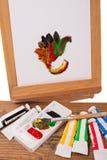 Acrylverven op een schildersezel Royalty-vrije Stock Foto