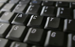 Act. Word on laptop keyboard Stock Photos