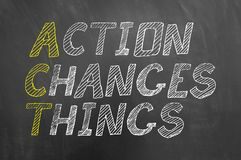 Act action changes things chalk text on chalkboard stock photo