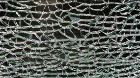 The act of malicious hooliganism. Broken glass wall. The act of malicious hooliganism. Broken glass wall of the new pavilion of the metro station. Abstract Royalty Free Stock Image