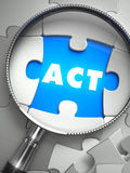 Act - Missing Puzzle Piece through Magnifier Stock Photography