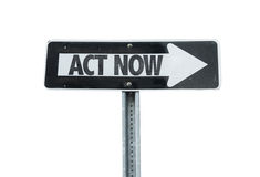 Act Now direction sign isolated on white Stock Photos