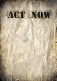 Act now letters on a vintage poster Royalty Free Stock Photos