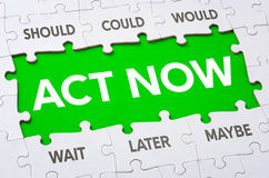 Act now. Text on puzzle pieces - Act now Royalty Free Stock Photo