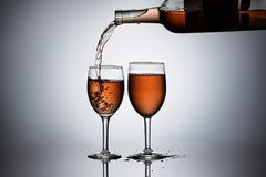 Act Of Pouring Wine Into A Glass. Royalty Free Stock Images