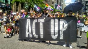 Act Up marching in Pride Parade 2017 NYC USA. Act Up marching in Pride Parade for Health Care and LGBTQ. Rights, Justice and an End to the Aids Crisis stock photography