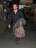 Acteur d'avatar Sam Worthington à l'aéroport de Sydney Photo stock