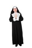 Acteur in een nun´skostuum met het bidden handen Stock Foto's