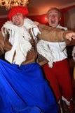 Acteurs de danse dans des costumes historiques image libre de droits