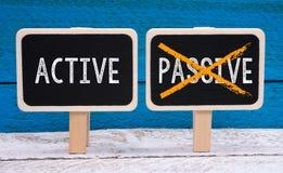 Actief in plaats van Passief stock fotografie