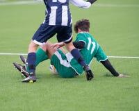 Acties op voetbalgebied Stock Fotografie
