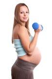Actieve zwangere vrouw stock fotografie