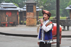 An acting male folk singer. This is a scene of national song and dance performances which in Yangshuo of guangxi zhuang autonomous prefecture of China. Taken on Stock Images