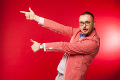 The acting man on red background Royalty Free Stock Photos