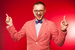 The acting man on red background Royalty Free Stock Photo