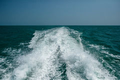 Acting wave behind motor boat Royalty Free Stock Photo
