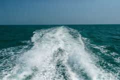 Acting wave behind motor boat at the vast ocean Stock Image