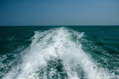 Acting wave behind motor boat at the vast sea Stock Photos