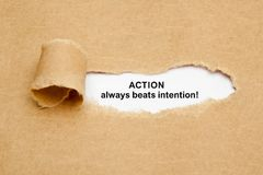 Action Always Beats Intention Torn Paper Concept Stock Photos