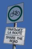 Action bilingue le signe de route Photos stock